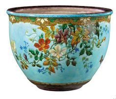 """DECK THÉODORE (1823-1891) Cover pot belly bulging neck and hemmed glazed ceramic polychrome decorated with flowers, butterflies and floral frieze on blue background. Signed the stamp hollow """"TH.Deck."""" Around 1880-1890. H: 29 cm Diameter: 39 cm A flower pot holder in polychrome enamelled ceramic decorated with flowers, butterflies and a floral border. Intaglio """"TH.Deck"""" signature. Circa 1880 to 1890."""