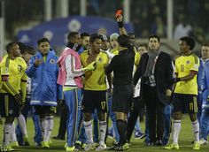Chilean referee Enrique Osses show a red card to Bacca as tempers flare following full-time of a precious win for Colombia