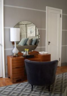 Master bedroom and guest room.  Great painted wall stripe. Geometric rug. Round mirror.