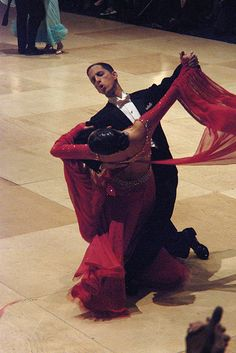 I love ballroom dancing! I think I want a red dress as well!