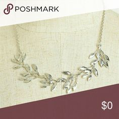 Multi Leaf Chain Necklace Multi leaf chain necklace. Length: 5 inches. Color: Silver. **Free Shipping: Submit offer for $6 less and I will accept.** Jewelry Necklaces