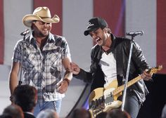 Luke- when he messed up his line at the CMAs. I LOVE a man that can laugh at his own mistakes! Complete hottness!!