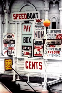 Signs on the West Pier, Brighton in 1968, photo by Peter Lane. The Pier was to close in 1975.