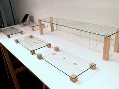 elevated flat glass with small blocks of wood jewelry display :: shihara | changefashion.net