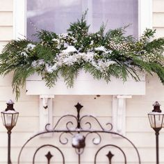 Turn your window boxes into a holiday display using berries and ferns. More holiday decorating ideas: http://www.bhg.com/christmas/outdoor-decorations/outdoor-holiday-decorating-ideas/?socsrc=bhgpin112812windowbox