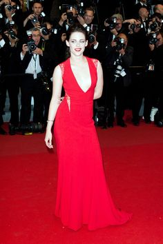 Kristen Stewart got sassy with her posing on the red carpet at Cannes in this red Reem Acra gown with lace cutouts.