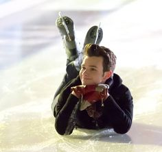 "Chris Colfer's Kurt Lies Down and Poses on the Ice Skating During Glee Season 4, Episode 10: ""Glee, Actually"""