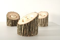 Tree log candle holders, add some greens - as Christmas  centerpieces on restaurant tables