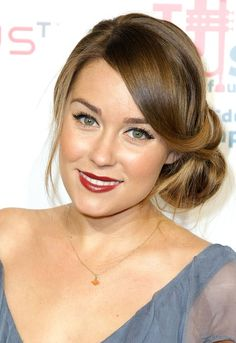 Lauren Conrad is the queen of California It-Girl style -- and her ultra-femme hairstyles are just as effortlessly glam! From boho braids to '40s-style curls to a bedazzled updo, click through to her dreamiest 'dos.