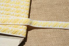 Vintage Ribbon Trim Embroidered Trim White with Yellow Scrolls. $1.50, via Etsy.