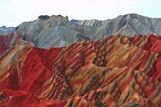 """Landforms at Zhangye Danxia Landform Geological Park in Zhangye City, northwest China's Gansu Province, on <span>July 7, 2014</span>. Danxia, which means """"rosy cloud,"""" is a special landform formed from reddish sandstone that has been eroded over time into a series of mountains surrounded by curvaceous cliffs and many unusual rock formations."""