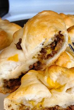 Ground beef sliders- cook 1lb of ground beef, add some ketchup,mustard, bbq and steak seasoning. Use a package of crescent rolls squared and place meat and cheese them. Roll up. Cook at 365 for 12 minutes.