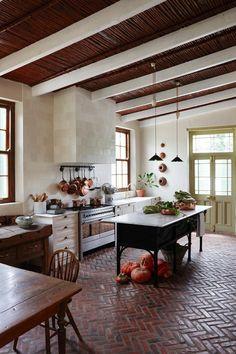 Tile floor in trad kitchen.