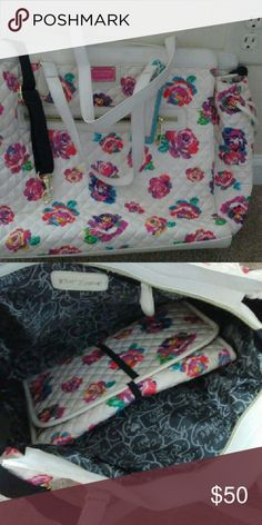 Betsey Johnson diaper bag White and multi colored floral print. This is in excellent shape and I used it once for when I was in the hospital . Bags Baby Bags