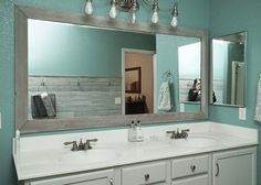 Bathroom Mirror Makeover diy bathroom mirror frame for under $10 | blue wood stain, diy