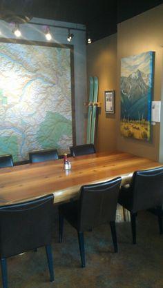Log table, Map Mural, handmade Falloon Skis, & Pemberton Meadows Painting by Karen Love in Mile One Eating House, in Pemberton Gateway Village Suites Hotel.