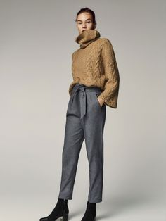 Trousers with darts and tied detail. Featuring a slim fit, zip fly with hook and eye for fastening, two side pockets, two welt pockets in the back and belt loops.