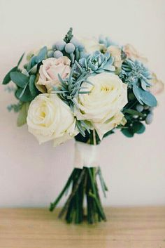 Petite Hand Tied Bouquet Of: White Roses, Cream Blush Roses, Succulents, Silver Brunia, Baby Blue Eucalyptus••••