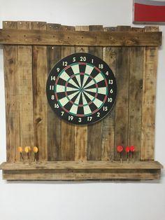Scrap pallet wood dartboard holder with shelf for darts.