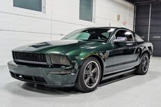 This 2009 Ford Mustang Bullitt was first sold at Woltz & Wind Ford of Carnegie, Pennsylvania and spend time in several states prior the selling dealer's acquisition in June 2021. Finished in Dark Highland Green over Dark Charcoal leather, the car is powered by a 4.6-liter V8 mated to a five-speed manual transmission and a limited-slip differential. Equipment includes air conditioning, 18″ wheels, a Kenwood stereo with a reversing camera, and tinted windows and lenses. 2009 Ford Mustang, Ford Mustang Bullitt, Ford Mustangs, Kenwood Stereo, Limited Slip Differential, Manual Transmission, Conditioning, Pennsylvania, Car