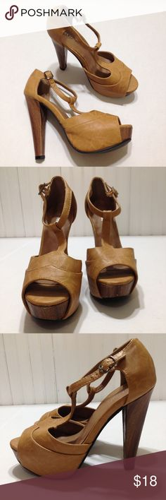 "Chestnut brown t-strap heels size 7 Chestnut brown t-strap heels size 7, heels are 5.5"" platform, a few scuffs on the front of on shoe as seen in the pictures otherwise good condition Wet Seal Shoes Heels"