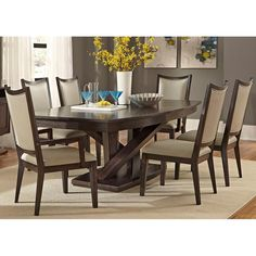 The crisscrossed table base adds a unique twist on a classic dining style. South Park 7 Pc. Dining Set | Weekends Only Furniture and Mattress