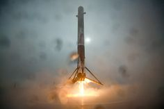 The Falcon 9 first stage descends to a soft landing on SpaceX's drone ship in the Pacific Ocean on Sunday. The rocket tipped over moments later. Credit: SpaceX