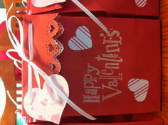 Valentines treat bag.  Very simple use a heart border punch on the top of a small paper treat bag.  Rubber stamp a sentiment.  Fold the top over about an inch, punch a hole on each corner and tie closed with ribbon.  Decorate with various sized hearts.