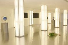 As a twist on the white-on-white look, Calvin Klein launched Euphoria in 2005 with an artsy installation that put the fragrance's tropical derivatives in display cases atop pedestals and on the floor. Videos of tropical landscapes could be viewed through metal portholes in the walls of the TriBeCa venue.