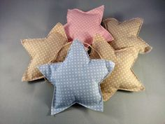 bunting di stelle in tessuto fatte a mano colori pastello baby - stars' bunting decorations for baby nursery, baby showers party #handmade #creativesewingproject #fabricpillow #fabricstars #nurserydecorations #homedecor #handmadewithlove #cucitocreativo #stelledistoffa #onceuponastar #bunting #buntingstelle #babyshowerdecorations #partydecorations #lovepolkadots #polkadots #stelle #stars