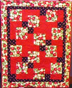 An apple lover's perfect quilt, long armed by Linda Christensen.