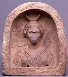 Votive relief of Selene - reddish marble carved found in Argos, at the British Museum
