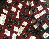"""A Melodious Blend Of Red, Black and White Delivered In Musical Harmony In This 43"""" X 45"""" Quilt"""