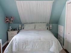 cute idea for adding texture to a bed under the eaves. Love the reading lamps too.
