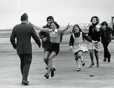 In this 1973 Pulitzer Prize–winning photo by Slava Veder, a released prisoner of war reunites with his family after returning home from Vietnam.