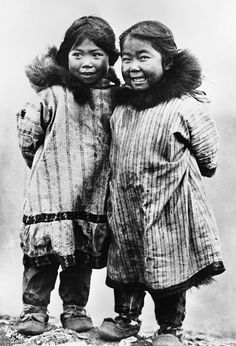 """Image No: ND-1-71  Title: Two laughing Inuit children, in native clothing, Nome, Alaska.  Date: [ca. 1900-1908]  Format of original: glass negative : b&w ; 8"""" x 10""""  Photographer/Illustrator: Lomen Brothers, Nome, Alaska / Dobbs, B.B.  Subject(s): Inuit - Children / Inuit - Clothing  Order this photo from Glenbow: ww2.glenbow.org/search/archivesPhotosResults.aspx?XC=/sea...  Search for 99,999 other historical photos at Glenbow: ww2.glenbow.org/search/archivesPhotosSearch.aspx"""