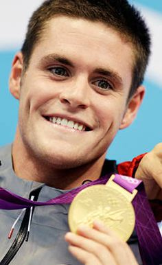 David Boudia    Here, the U.S. diver celebrates with the gold during the medal ceremony for the men's 10-meter platform diving final Saturday. It was the first gold medal in diving for the U.S. since 2000
