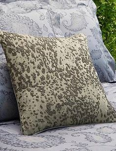 Boasting an elaborate hand-stitched beaded design, the SFERRA Tobiano Decorative Pillow is sure to add shimmer and metallic style to your seating space.