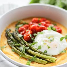 This Roasted Tomato & Asparagus Polenta is so simple to make and it's packed with flavor and topped with the most perfectly poached egg!
