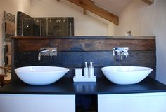 Project Portfolio: conversion of an ancient and important heritage Grade II* listed building in Bude, Cornwall. The Bazeley Partnership successfully gained planning permission for our client to restore, repair and convert the dilapidated barn into a stunning, contemporary family home. Winner of a Cornish Buildings Group Award 2015. Master bathroom.