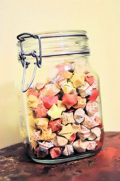 write a wish on paper and fold into little origami stars and fill a jar up. read years later for memorys.