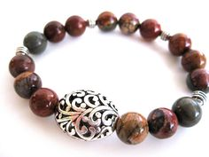 Bohemian beaded stretch bracelet handmade by Rock & Hardware Jewelry, a member of The Artisan Group