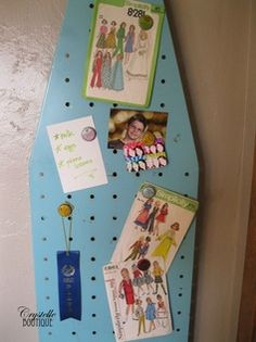 Vintage ironing board as magnet board.  So super clever!!!!