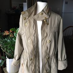 "For Cynthia Size L  trench coat Beautiful piece with lot a golden zippers and hardware ,lined ,lightweight,elastic waist. Back slightly longer than front , very good condition . Back length 33"".  Front length 26.5"". For Synthia Jackets & Coats Trench Coats"