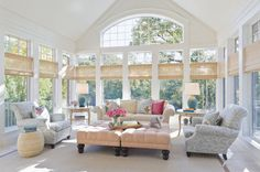 Monet's Softer Colors.  Vaulted breadboard ceiling and grass woven shades.  Traditional Sunroom by Lucy Interior Design