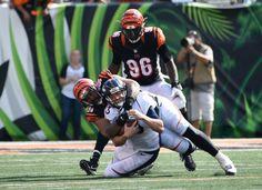 Denver Broncos quarterback Trevor Siemian (13) gets wrapped up by Cincinnati Bengals defensive tackle Domata Peko (94) during the fourth quarter September 25, 2016 at Paul Brown Stadium. John Leyba, The Denver Post