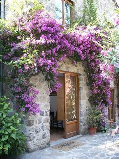 A Beautiful Italian Entry Way covered in Pretty Violet Flowers
