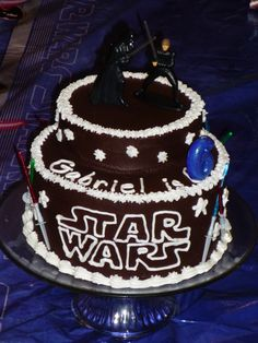 """This was a pretty simple cake to make.  Star Wars figurines on top with lighted sabers really stole the show.  10"""" base with 6"""" top iced with chocolate icing and piped with white designs."""