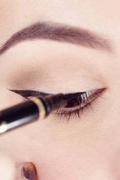 <p>Finish the line by going back to the middle of your eye and sketching short thin strokes over to the tear duct. By the time the liner reaches the inner corner, the streak should hug the lashes as tightly as possible.