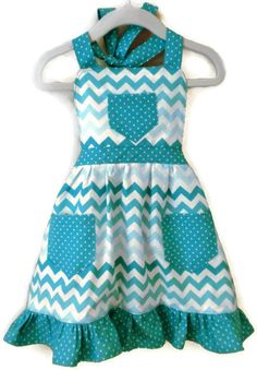 Your little girl will enjoy wearing this adorable chevron apron while playing in her toy kitchen or helping you bake in the family kitchen! The